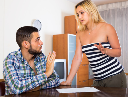 russian woman: Tired young  man explaining contract terms to girlfriend. Focus on man