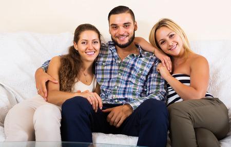 polygamy: Portrait of happy two charming girls with boyfriend