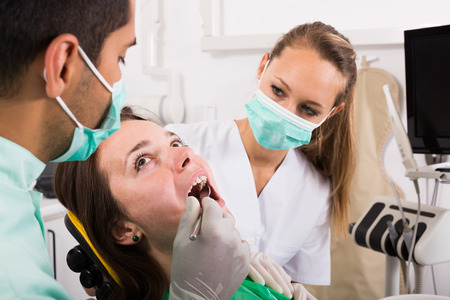 hospital patient: Scared russian patient treating at the dental hospital Stock Photo