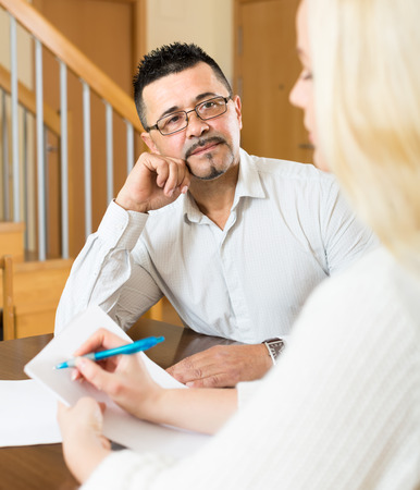 come home: Male social worker has come home to a woman to full in papers