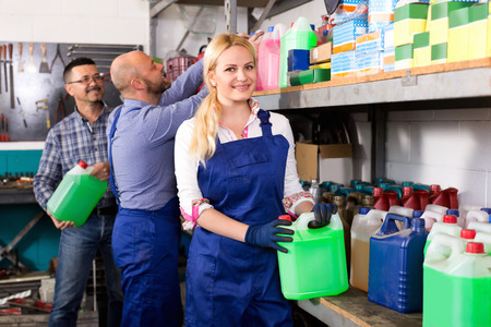 25s: Troubleshooters and smiling superviser at storage of auto repair shop