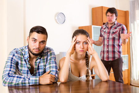 polygamy: conflict in adult polygamous family indoors. Focus on the couple