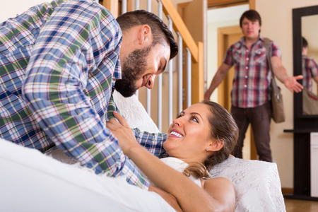 coming home: cheating spouse coming home and saw unfaithful woman