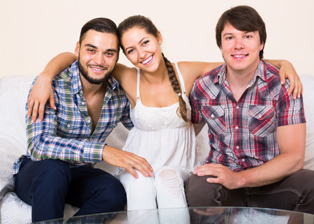 bisexual women: Three happy american adult partners in home interior
