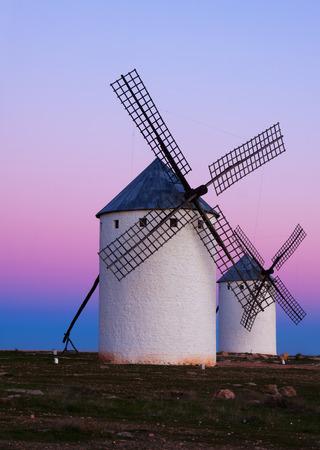 mancha: Two windmills at field in evening. La Mancha, Spain