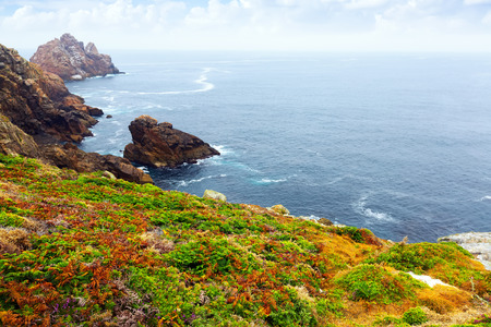 tranquil: Cliffs at ocean  coast  in tranquil cloudy day. Galicia, Spain