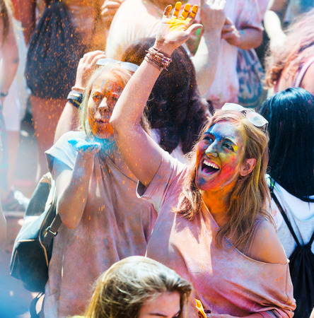colores: BARCELONA, SPAIN - APRIL 12, 2015: Happy woman at  Festival de los colores Holi in Barcelona. Holi is traditional holiday of India Editorial