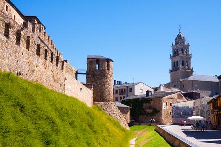 castile: PONFERRADA, SPAIN - JUNE 28, 2015: Wall of  Templar Castle and city street.  Ponferrada, Castile and Leon, Spain