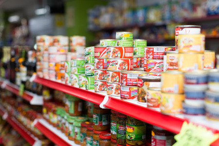 canned goods: BARCELONA, SPAIN - MARCH 22, 2015: Canned goods at groceries section of average Polish supermarket Editorial