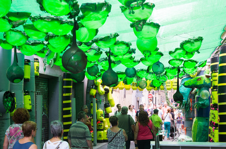 toxic waste: BARCELONA, SPAIN - AUGUST 16, 2015:  Gracia Festa Major in Barcelona, Catalonia. Decorated streets of Gracia district. Theme of toxic waste Editorial