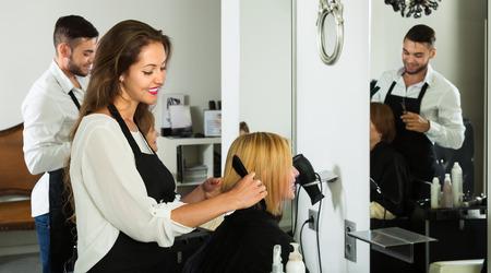 hairtician: Young girl cuts hair at the hair salon