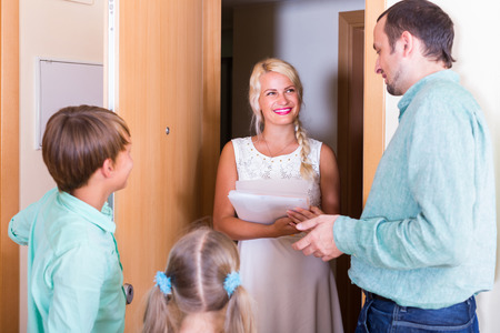 inspector kid: Housing community inspector greeting family of new tenants Stock Photo