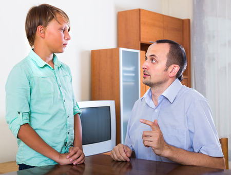 offended: Offended man arguing about problems  with teenage son