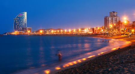 View of Barceloneta Beach in summer evening in Barcelona Stock Photo