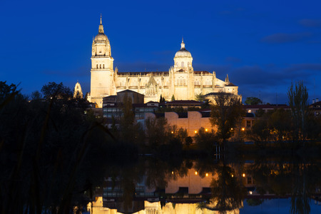 castile: Salamanca Cathedral from  River  in  night. Castile and Leon, Spain Stock Photo