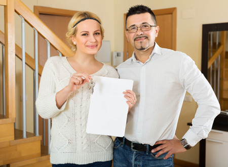 hypothec: Happy husband and wife signing a contract and buying apartment Stock Photo
