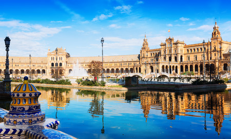 sunny: Day sunny view of Plaza de Espana with reflection. Seville, Spain