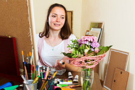 contentedness: Young artist fascinated by the process of painting a new picture