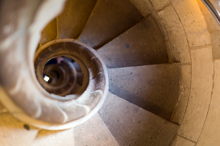 Close up view at narrow stone spiral stairway
