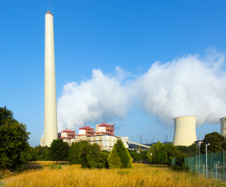 cooling towers: Industrial plant with chimney and cooling towers in  summer day