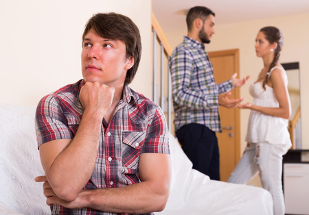 polygamy: Unhappy adults having troubles argue at home interior Stock Photo