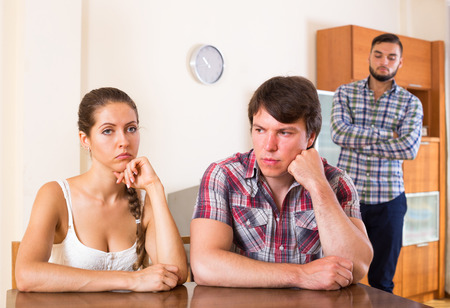 quarrel: Young family thinking about quarrel with partners at home