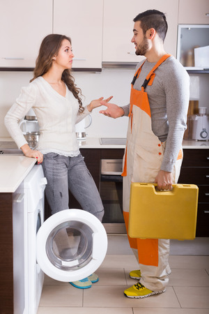 aftersales: Professional workman visiting female customer for after-sales service at home