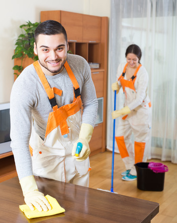 house cleaning: Portrait of cleaning premises team with equipment working at client house