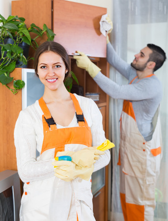 houseman: Portrait of positive smiling professional cleaners team with equipment Stock Photo