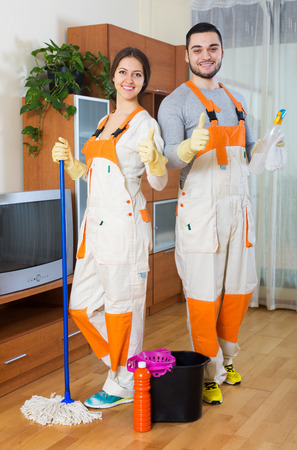 houseman: Smiling professional cleaners with equipment cleaner of client house