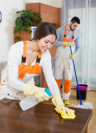 houseman: Professional cleaners with equipment cleaner furniture of client house Stock Photo