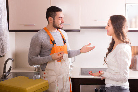 Professional workman visiting customer for repairing water lines Stock Photo