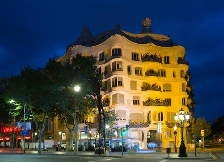 BARCELONA, SPAIN - JUNE 23, 2015: Night view of Casa Mila (La Pedrera)   in Barcelona, Catalonia.  House was built in 1905–1910 by  architect Antoni Gaudi Editorial