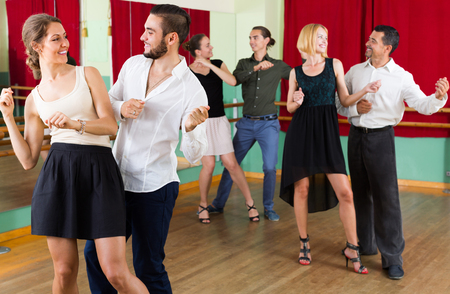 dance steps: Energy young people dancing active dance at studio