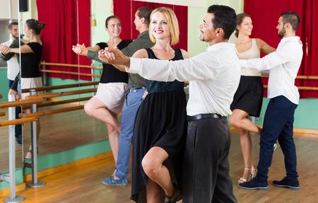 tango: adult spanish men and women enjoying of tango in class