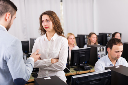 working area: Strict boss and crying clerk at open space working area Stock Photo