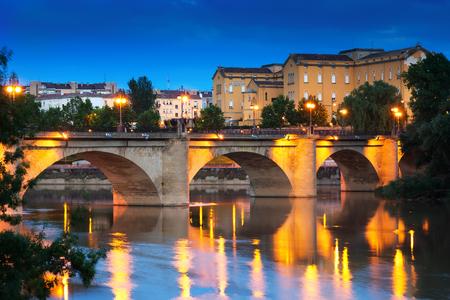 rioja: ancient stone bridge over Ebro  in evening. Logrono, La Rioja Stock Photo