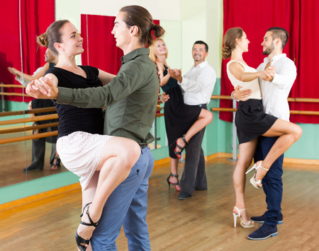 unprofessional: young european men and women enjoying of tango in class Stock Photo