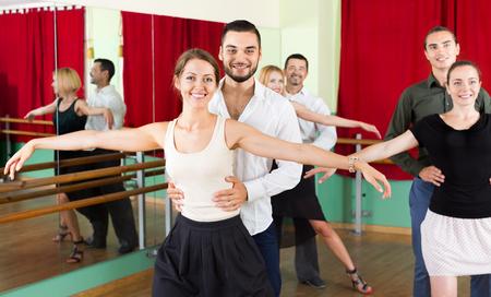dancing man: Tree happy young couples dancing waltz in dancing-class