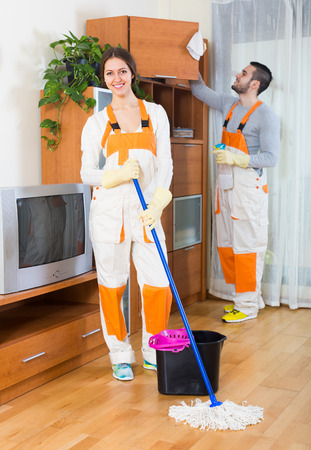 houseman: Portrait of positive smiling professional cleaners team in uniform Stock Photo