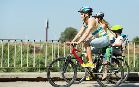 family bike: Bike ride young family with two kids in a summer day Stock Photo