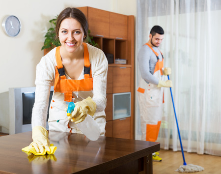 houseman: Portrait of positive professional cleaners with equipment