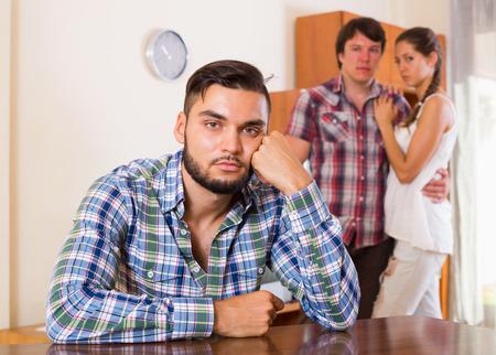 polygamy: Three unhappy partners having troubles at home interior