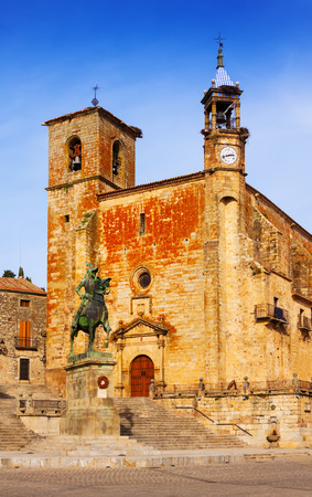 Day view of Church and Equestrian statue of Francisco Pizarro at  Plaza Mayor. Trujillo, Caceres
