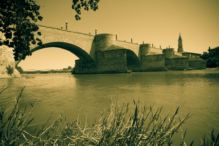 zaragoza: Retro photo of Stone Bridge over Ebro river. Zaragoza, Aragon