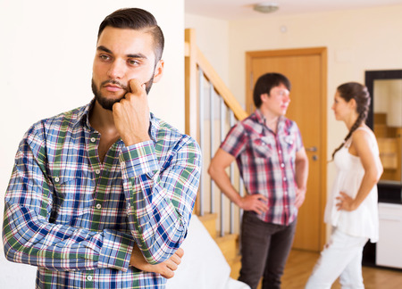 quarrel: Quarrel among young partners at home in the living room Stock Photo