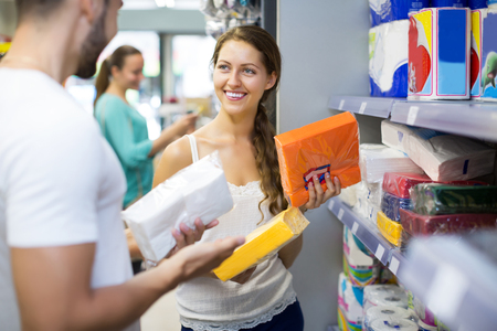sudarium: Happy young women buying napkins for kitchen in the shopping mall