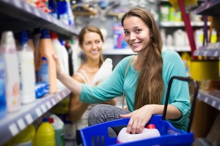 vend: smiling american people buying detergents for house in the shopping mall Stock Photo