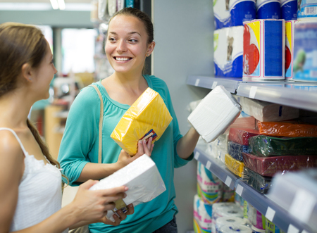 sudarium: Happy women buying napkins for kitchen in the shopping mall