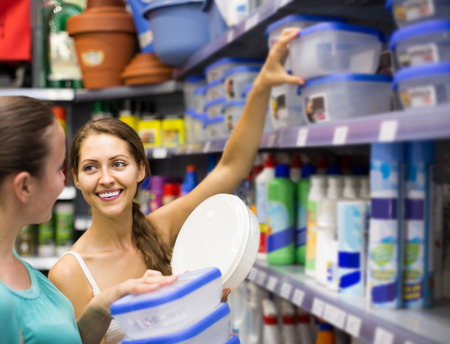 vend: happy european girl buying pails in the shopping mall